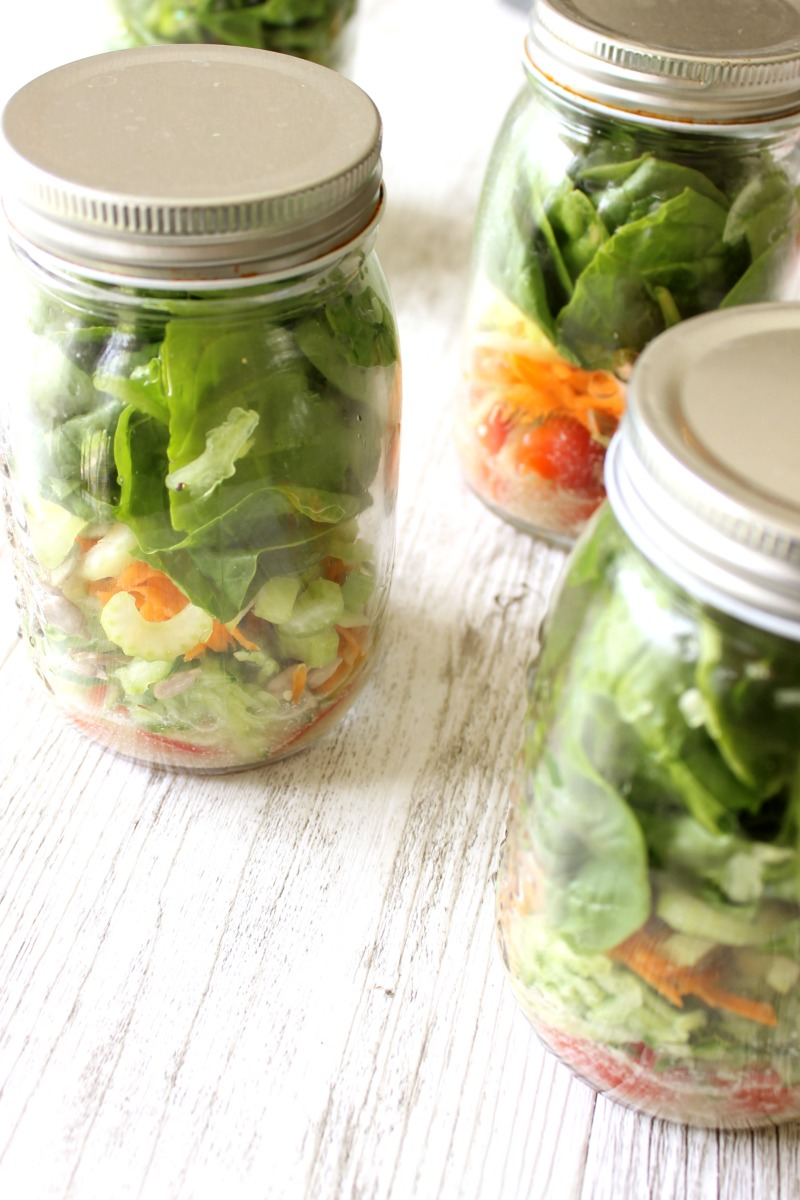 Salad in a jar is one of the easiest week-day meals and one of the most portable options for those of us on the run.  Dressing, fresh salad, nuts and seeds.